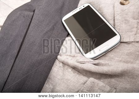 Photo of a Smartphone on some linen cloth.