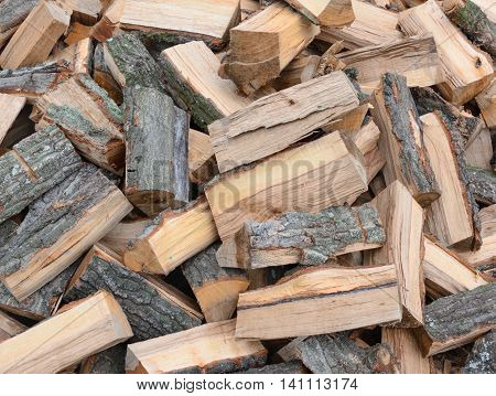 A lot of firewood in a horizontal format