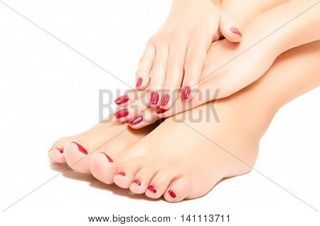 Beautiful  foot and hands with red manicure isolated on white background