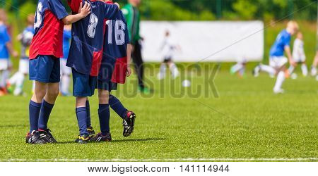 Young football players on the pitch. Grass sports field. Horizontal youth soccer picture.