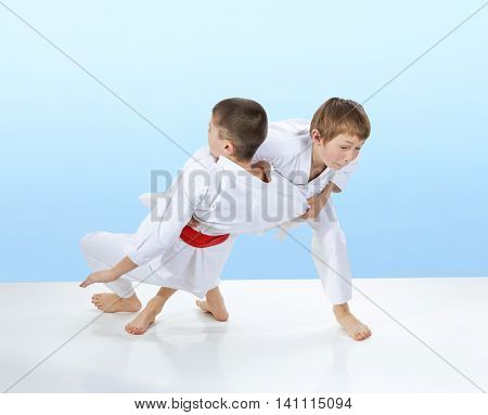 Judo throws are training two athletes on the light background