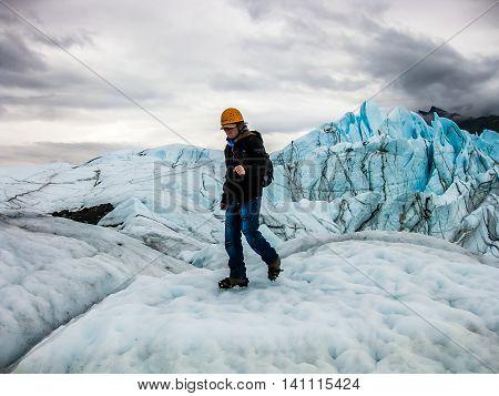 Sporty man makes trekking on the Matanuska Glacier, Matanuska Glacier State Recreation Area, Alaska, USA