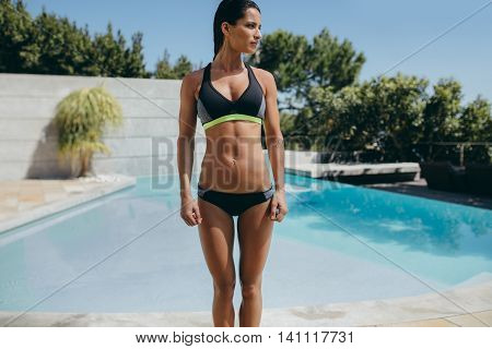 Female Athlete Standing By The Poolside