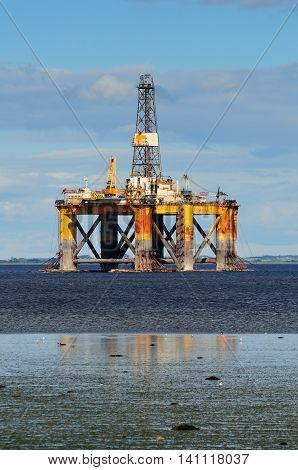 Offshore oil platform with reflection, North Scotland