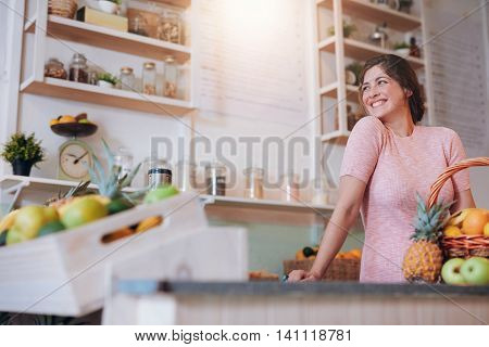 Beautiful Woman Standing Behind The Counter Of Her Juice Bar