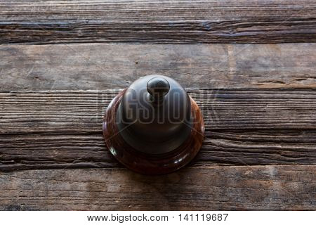Classic Service Bell On Wooden Table