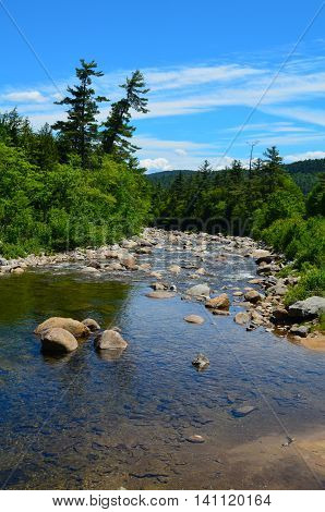 Riverbed on a summer day at the Lower Falls Scenic Area in the White Mountain National Forest.