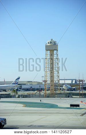LOS ANGELES, UNITED STATES - DECEMBER 28: A lookout tower at LAX airport and the departure of the Israeli airline El Al on December 28, 2015 in Los Angeles.