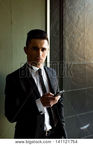 Man In Suit With Smartphone