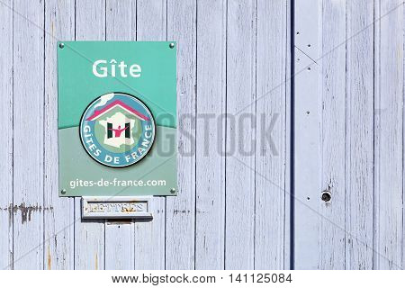 Odenas, France - July 4, 2016: Gites de France signboard on a door. Gites de France is a holiday home in France available for rent.
