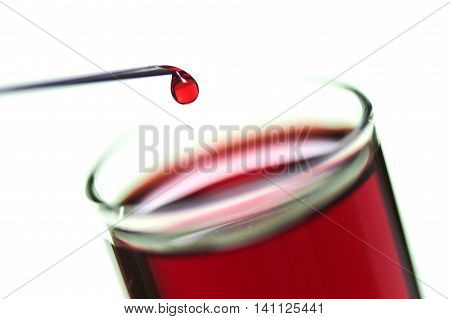 Drops of blood leaking from the needle of a syringe piston