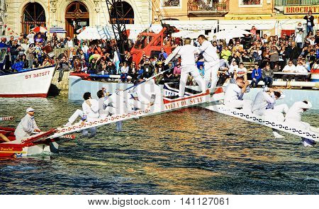 SETE, FRANCE - March 26 2016: Water Jousting performance during Stopover in Sète - Maritime Traditions Festival from the 22 to 28 march 2016 at the streets of Sete South of France
