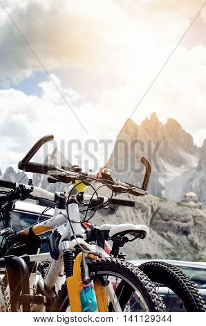 bicycles on a road. Detail of handlebar. Sports and leisure.