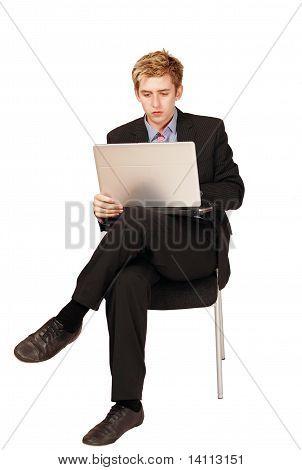 Male traveler on laptop
