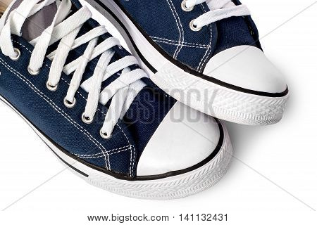 Closeup of dark blue athletic shoes isolated on white background