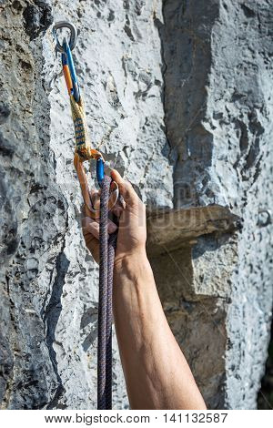 Carabiner, spit and climbing rope. Free climbing gear