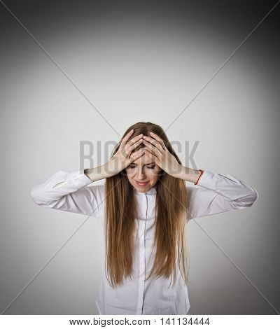 Sad and Unhappy woman in white. Tears welled up in her eyes. Headache concept.