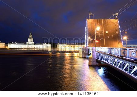 Palace Bridge Neva River and University Embankment at night in St.Petersburg Russia.