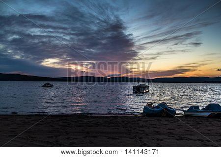 amazing colorful evening sky sunset over lake at summer time long exposure St-Gabriel-de-Brandon Maskinonge Lake Quebec Canada