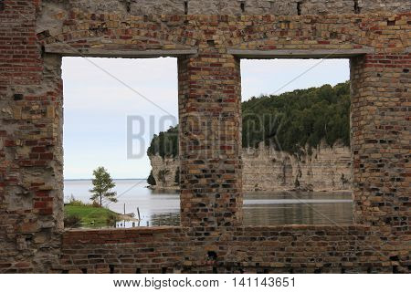 Looking through window ruins in a ghost towns in Michigan's Upper Peninsula