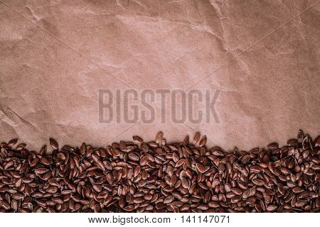 Healthy diet organic nutrition. Brown raw flax seeds linseed border frame on paper background