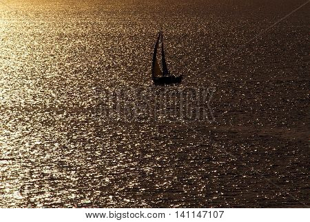Lonely sail. Baltic Sea, Poland - August 18, 2009 Lonely sailboat in the Baltic Sea in the glow of the setting sun.