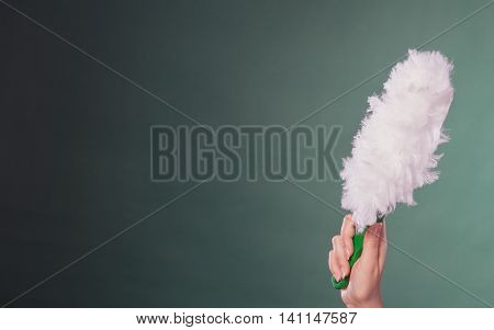 Young Person With Cleaning Item.