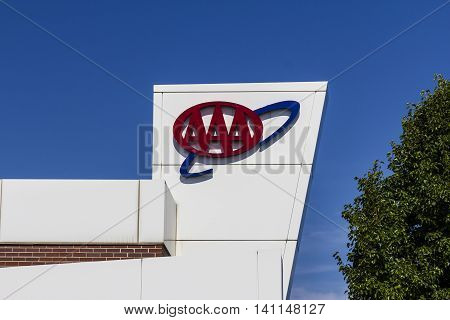 Muncie IN - Circa July 2016: AAA Travel & Insurance Sign. The American Automobile Association Provides Roadside Assistance, Jump Starts and Discounts to its Members I