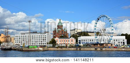 HELSINKI, FINLAND SEPTEMBER 25 2015: Market Square (Kauppatori) and Finnair skywheel in central square in Helsinki and one of most famous market places and tourist attractions. Located in South Harbor