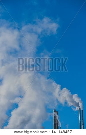 Smoke Stack Emitting Against Blue Sky Industry