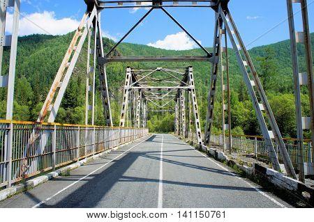 Iron bridge over the river. Siberia. Khakassia.