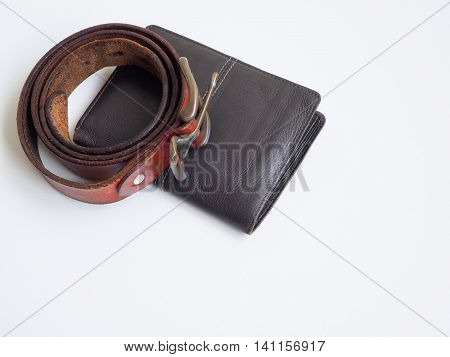 Brown leather wellet bag and belt on white background.