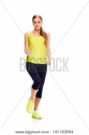 Running fit fitness sport model jogging smiling happy isolated on white background. Caucasian fitness girl training.