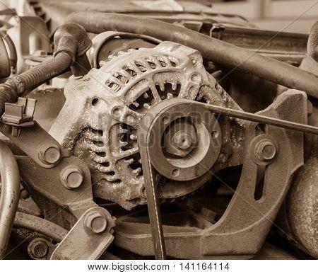 Old alternator for the car attached on engine vintage effect