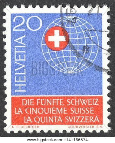 MOSCOW RUSSIA - CIRCA APRIL 2016: a post stamp printed in SWITZERLAND shows Globe with Swiss cross dedicated to the 5th Switzerland Year
