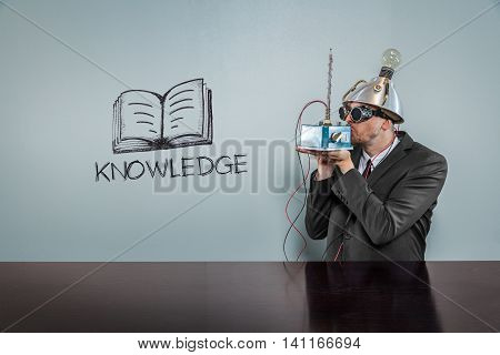 Knowledge text with vintage businessman kissing machine