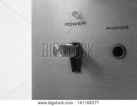 Old power switch button and phone plug of retro audio in black and white effect