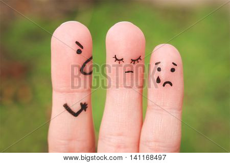 Finger art of family during quarrel. The concept of man scolds his wife and child, woman is sad, baby is crying