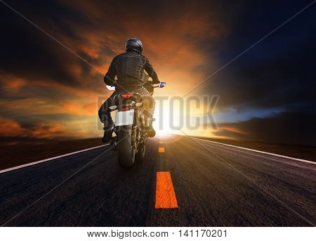 young man riding big motorcycle on asphalt highway use for people leisure and motorsport activities