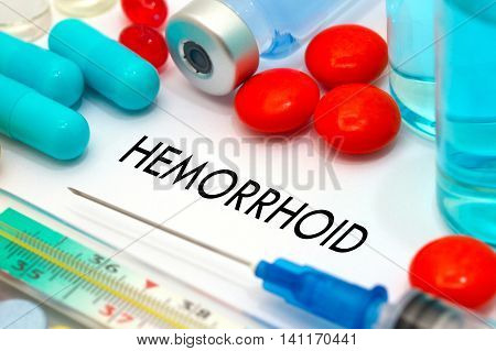 Hemorrhoid. Treatment and prevention of disease. Syringe and vaccine. Medical concept. Selective focus
