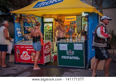 BALAKLAVA CRIMEA. UKRAINE - JULY 25 2010: Tourists relax on the waterfront in the evening