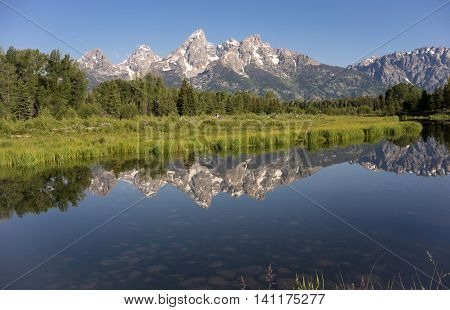 Rocky Mountain Range Reflected Smooth Water Grand Teton National Park