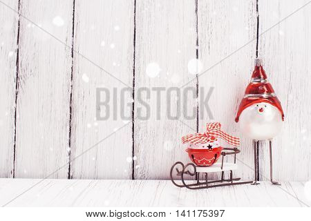 Xmas or new year composition with sledge, small bell and funny bird