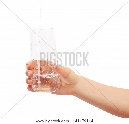 Water Pouring Into Full Drinking Glass In Woman's Hand
