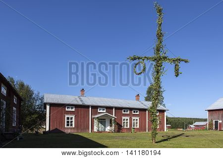 GRANO, SWEDEN ON JUNE 26. View of an old wooden and ancient home, Sjungaregarden on June 26, 2016 in Grano, Sweden. Traditional building from 18th century. Shadows and sky. Editorial use.
