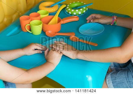 Two Young Children Playing With Kitchen Toys