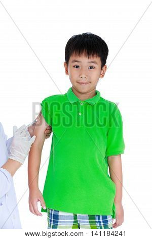 Doctor vaccinating boy's arm. Asian illness boy get an injection vaccination. Isolated on white background. Human health care and medical concept.