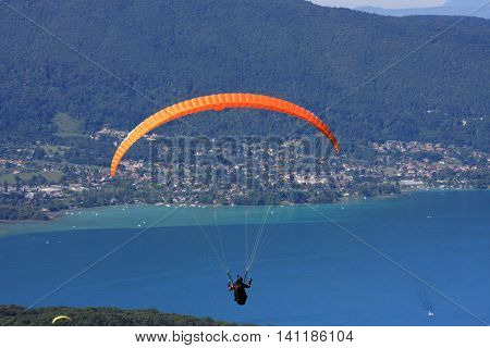 Paraglider flying above Lake Annecy in France