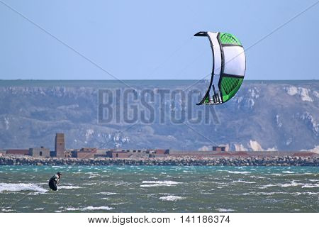 kitesurfer riding his board in Portland Harbour