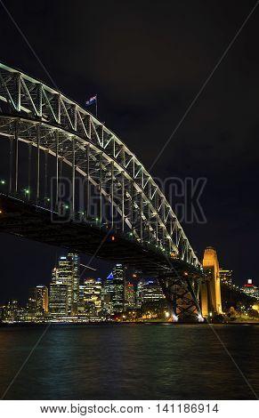 famous sydney harbour bridge and CBD skyline landmarks in australia at night